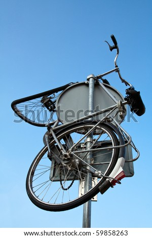 Bicycle thrown on a traffic sign in The Netherlands. - stock photo