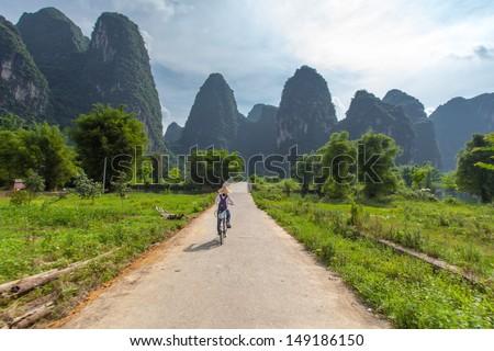 Bicycle tours around  Yangshuo, Guangxi, Guilin, China - stock photo