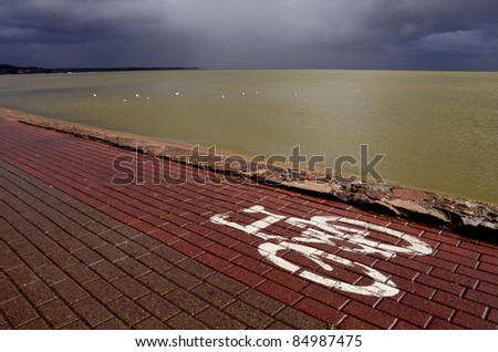 bicycle track on the sea bay after autumn rain
