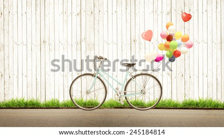 bicycle vintage with heart balloon concept of love in summer and wedding honeymoon, white wood background - stock photo
