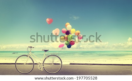 bicycle vintage with heart balloon on beach blue sky concept of love in summer and wedding - stock photo