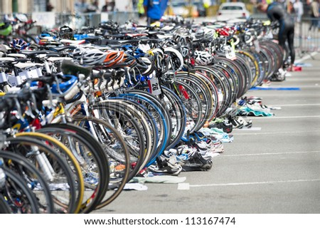 bicycle waiting at triathlon - stock photo