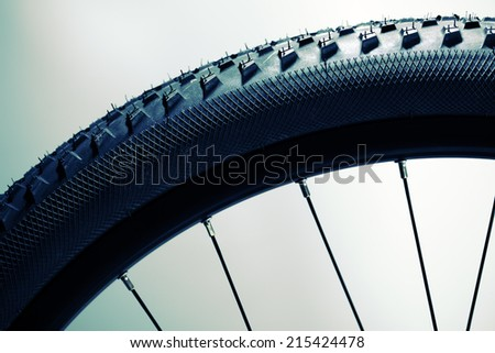 Bicycle wheel and tire close up abstract - stock photo
