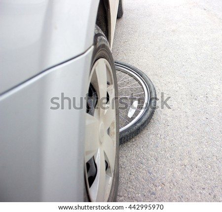 bicycle wheel under the car