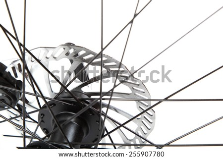 Bicycle wheel with spokes isolated on a white background. - stock photo