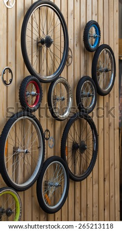 Bicycle wheels are hanging on the wall - stock photo