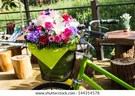 bicycle with a bucket of colorful flowers