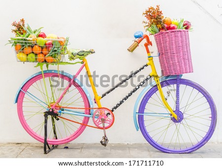 Bicycle with basket fruit and flower - stock photo