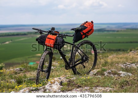 Bicycle with orange bags for travel