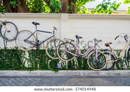 Bicycles hanging on wall for decoration. - stock photo