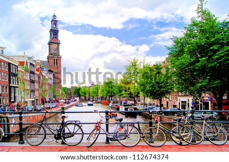 Bicycles lining a bridge over the canals of Amsterdam, Netherlands - stock photo