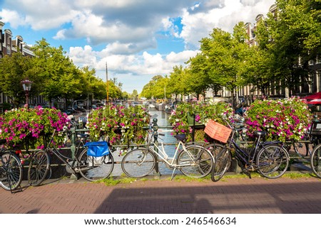 Bicycles on a bridge over the canals of Amsterdam. Amsterdam is the capital and most populous city of the Netherlands - stock photo