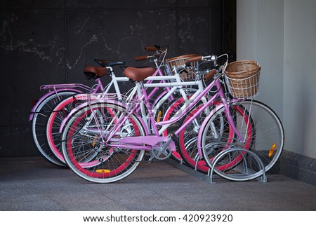 Bicycles parked in a bike rack in the city of Melbourne, Australia - stock photo