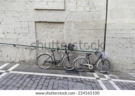 Bicycles parked in urban street, vehicle and transportation - stock photo
