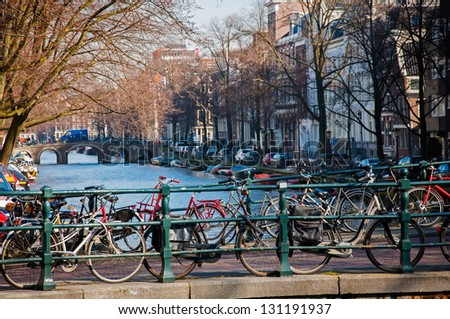 Bicycles parked on a bridge in Amsterdam