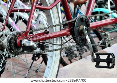 Bicycles standing in a row in a city street for hire - stock photo