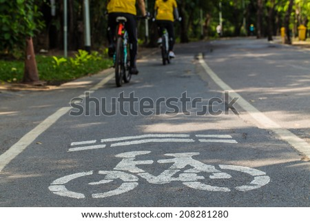 Bicyclist in bike lane, movement of cyclist in the park - stock photo
