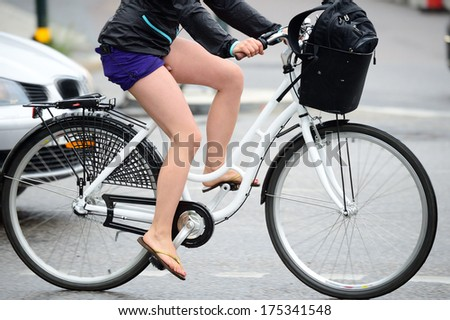 Bicyclist in rainy traffic - stock photo
