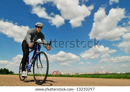 bicyclist on a background of the blue sky