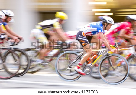 Bicyclist Race In Motion Blur