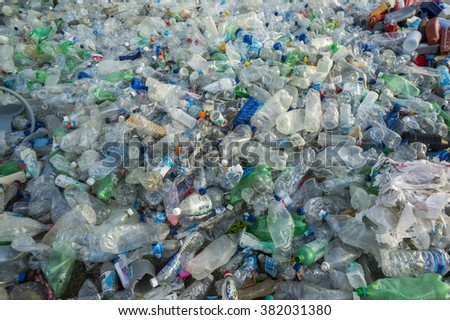 BIDUK BIDUK, INDONESIA - FEB 11: Clear plastic bottles lie in a heap at an undisclosed recycling facility on Feb 11, 2016 at Kalimantan Indonesia - stock photo