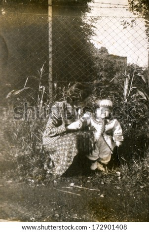 BIELSKO, POLAND, CIRCA FORTIES - Vintage photo of mother with a son