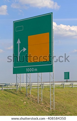 Big Advance Directional Sign at Highway Road