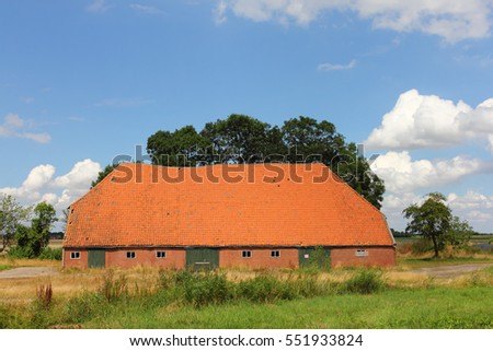 Big agricultural building, blue sky in background