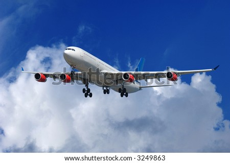 Big airliner on blue and cloudy sky. - stock photo