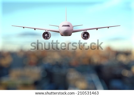 big airplane flying over the city