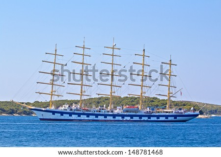 Big Ancient Ship In Blue Deep Sea.  - stock photo