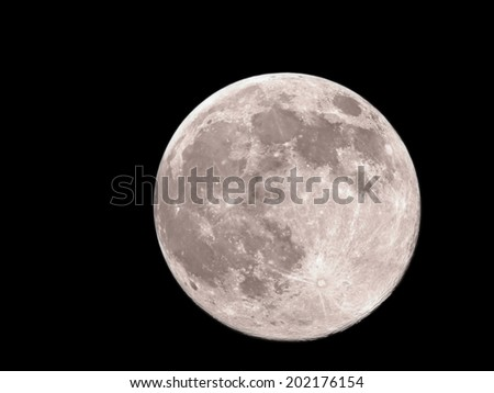 Big and bright full moon.Close-up of moon against black night sky. - stock photo