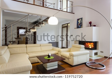 Big and comfortable living room with bright sofa - stock photo