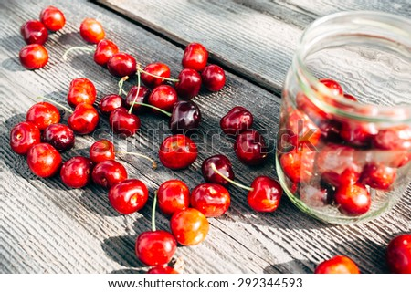 Big and fresh cherries on the wooden background