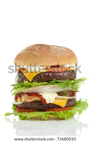 Big and good looking hamburger stacked high on white background - stock photo