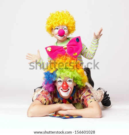 big and little funny clowns - stock photo