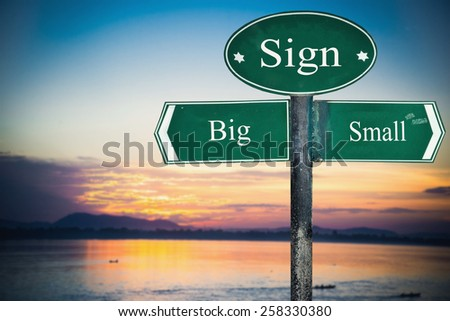 Big and Small directions. Opposite traffic sign. - stock photo