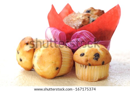 big and three mini muffins on table  - stock photo