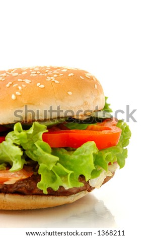 Big appetizing hamburger with vegetables close-up isolated junk food on white background side view - stock photo