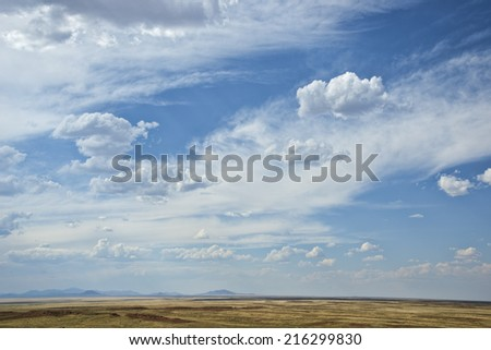 Big Arizona sky near Winslow, flat desert landscape with hills in the distant - stock photo