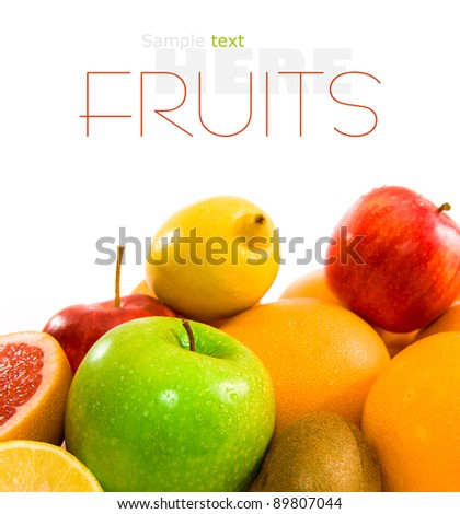Big assortment of fruits of a white background - stock photo