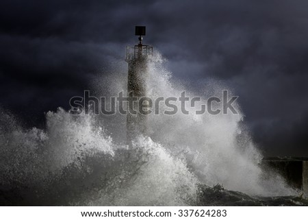 Big Atlantic stormy waves over lighthouse. North of Portugal. Enhanced sky