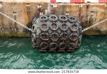 Big attraction ball and old tires for big ship   - stock photo