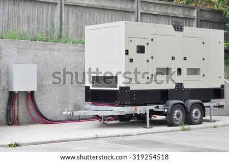 Big Backup Generator for Office Building connected to the Control Panel with Cable Wire - stock photo