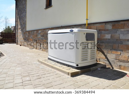 Big Backup Natural Gas Generator for House Building Outdoor - stock photo