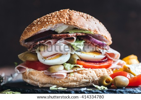 Big bagel sandwich with turkey breast and eggs,selective focus  - stock photo
