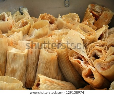 Big batch of tamales in a pot - stock photo