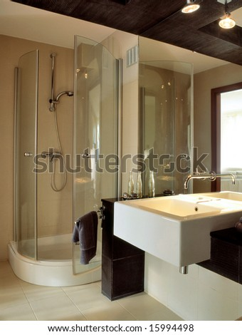 big bathroom with glass wall - stock photo