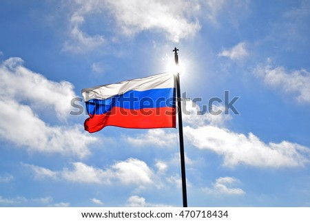 Big Beautiful Russian flag on the sky background