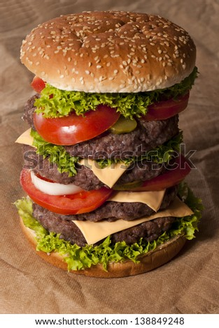 Big beef burger with vegetables. Selective focus on the content of burger